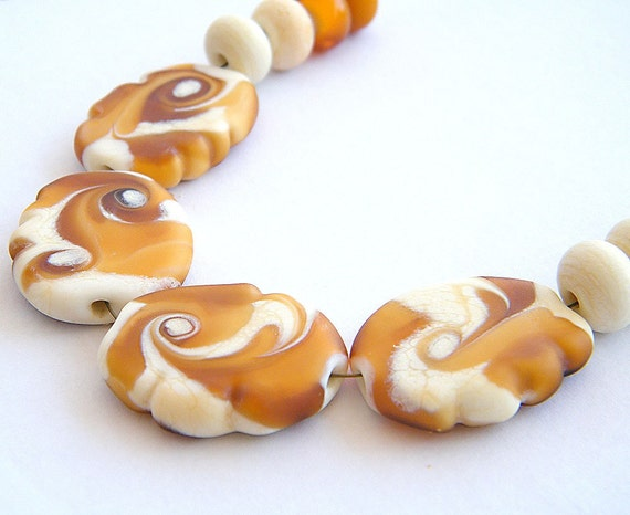 BINDU- 4 pressed Lampwork beads / pendants, 4 round in ivory and 4 spacer.