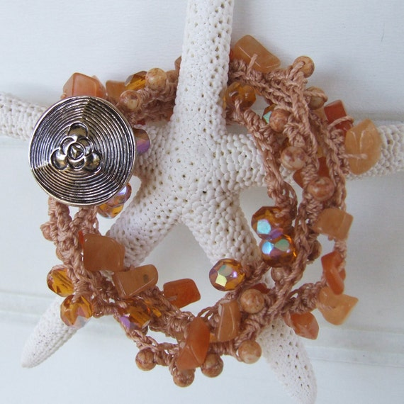 Coastal crocheted bracelet of bronze cording with cut crystal and natural stone beads