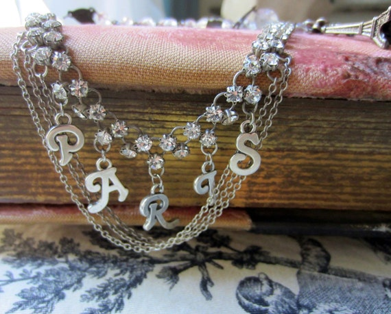 RESERVED for Priscilla - paris by starlight - vintage assemblage necklace with sterling charms, rhinestones and rosary by the french circus