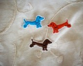 Vintage applique of a dachsund dog in a hand loomed applique