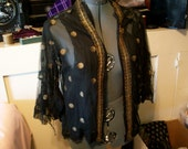 Cool metal and cotton net make up this display piece