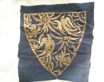 Metal embroidery applique on black crepe