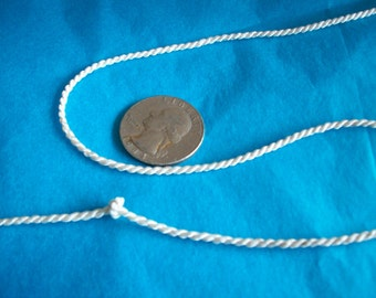 5 yds. of a tiny rayon twisted ivory cord