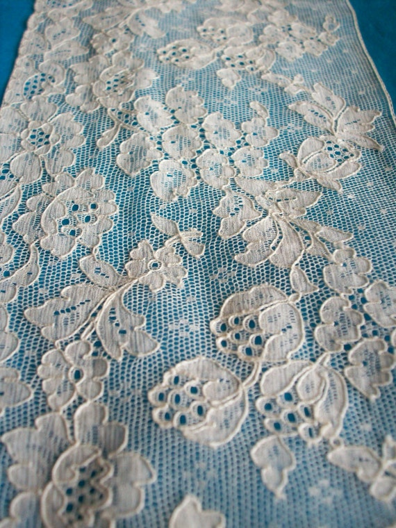 1 piece of an Antique french salesman's sample of  lace in white ,more avail.