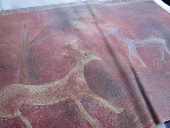 "primitive BATIK fabric panel -- antelopes and elephants-- 57"" wide x 10"" tall"