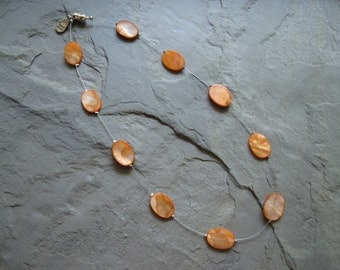 orange mother of pearl floating necklace