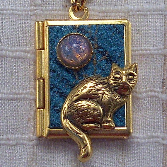 CAT Love Book Necklace, gold and aquamarine, holding 14 ways to tell someone you love them, from English to American Sign Language.