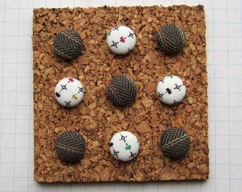 A Set of Fabric Covered Thumbtacks