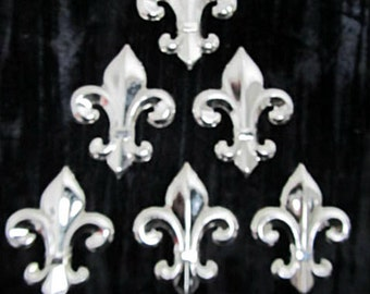 Fleur-De-Lis Metal Jewelry Stamping Six Pieces of  2 3/4 inch Chrome Silver Plated Over Brass Hollow Back Fleur-De-Lis Jewelry Findings.