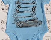 Lil' Ludi's Race Cars- 0 to 3 month infant, boys, baby, bodysuit, cream, baby blue, chocolate, cars