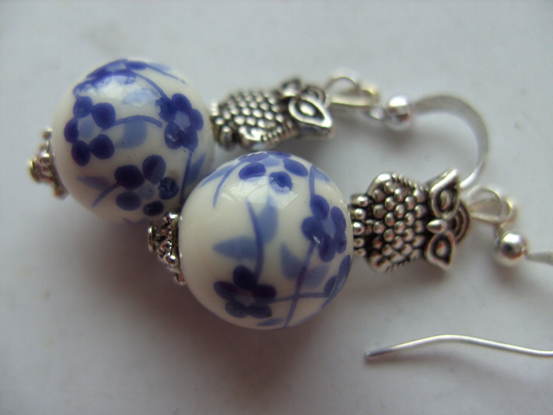 blue and white flower owl earrings delft blue style