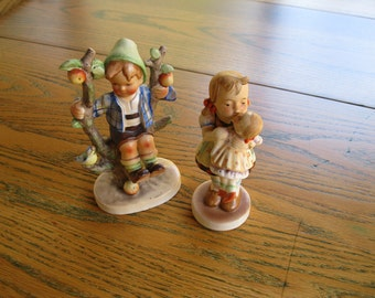 Made in Japan  Pair of Figurines, Boy Sitting in Apple Tree, Girl Holding Doll