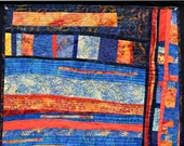 Abstract art wall quilt geometric shapes in blue and orange
