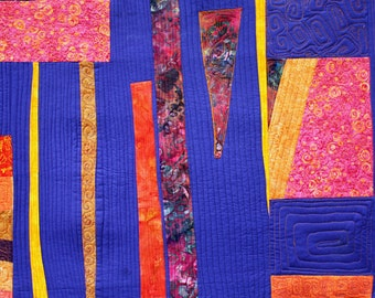 A contemporary art quilt, Modern geometric wall hanging in gold purple and orange
