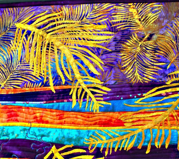 abstract wall quilt with applique ferns and  fun quilting  in purple and gold batiks