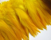 "Three inch strip Yellow Strung Rooster Furnace Saddles Feathers (individual feather around 4"")"