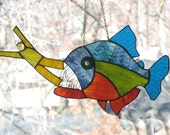 Piranha Eating a Man Stained Glass Suncatcher