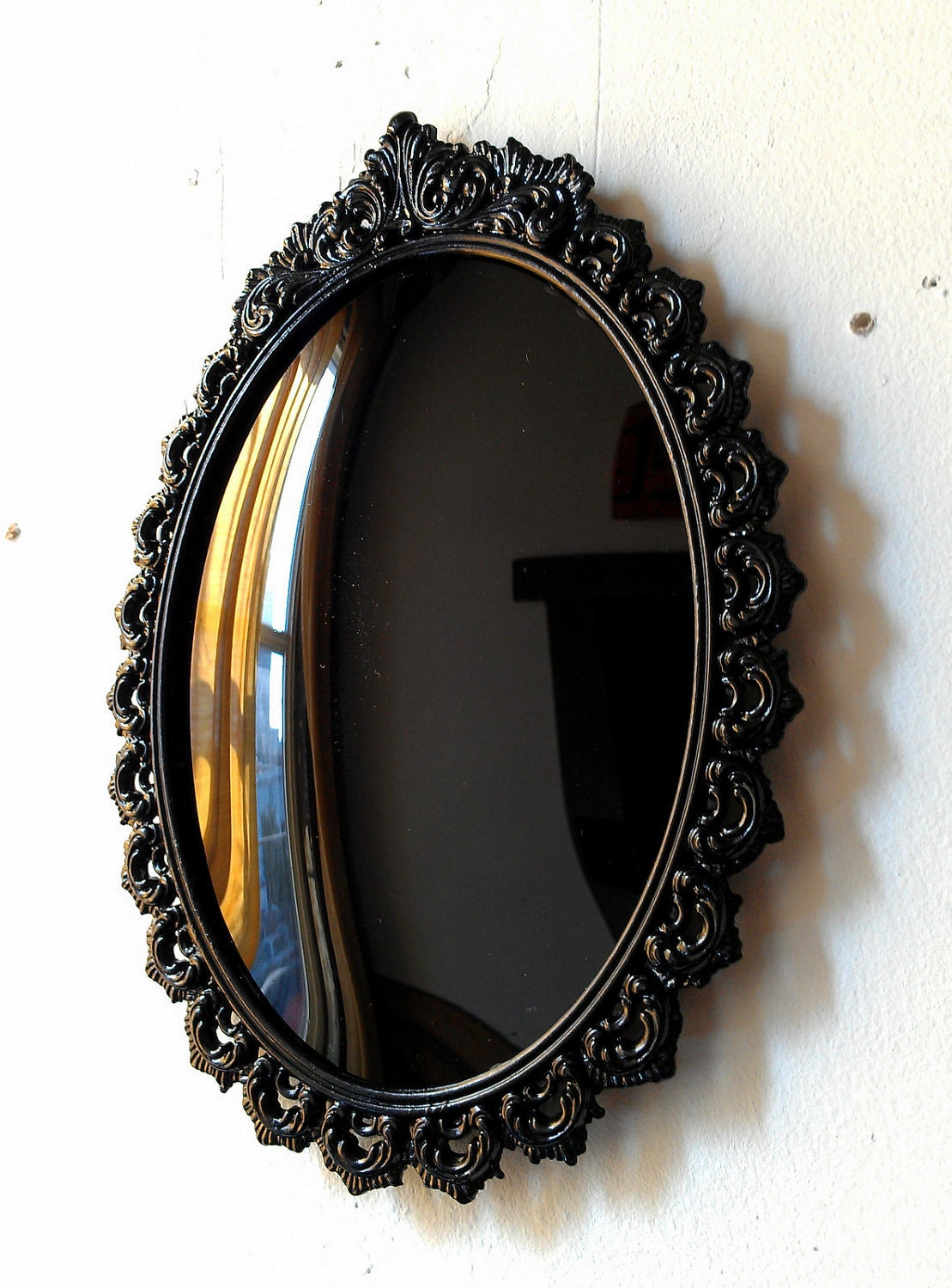 black convex scrying mirror in vintage oval frame 9 by 6