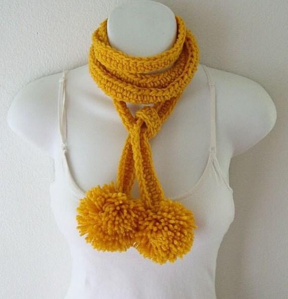 fun flirty pom poms scarf in Gold