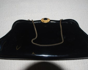 vintage, black, shiny, vinyl, clutch, purse, with gold brooch clasp, chain handle, evening, formal,