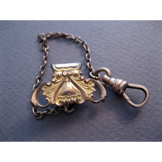 antique victorian FOB - ornate, beautiful workmanship, embossed stamping, signed The DFB Co.
