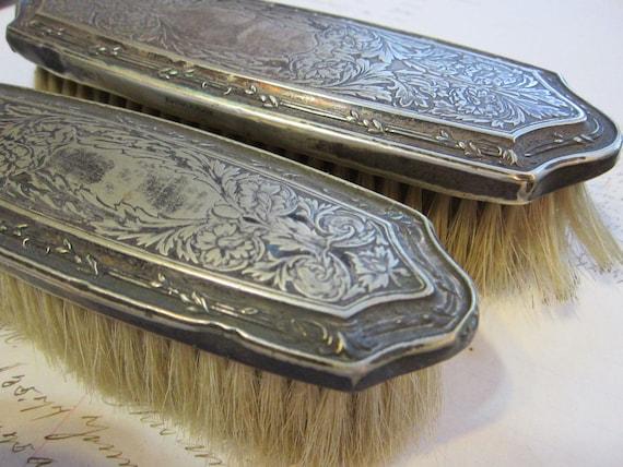 SALE - 2 vintage vanity brushes - quadruple silverplate - tooled metal