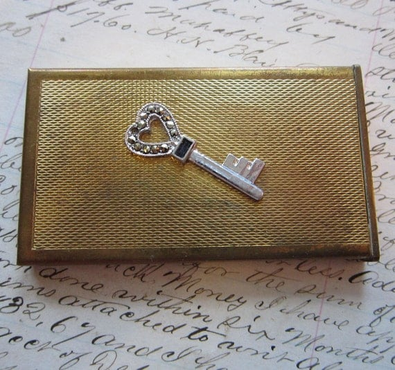 small metal box - gold tone with heart shaped key embellishment