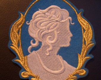 white on turquoise embroidered cameo iron on patch with gold trim ready to ship