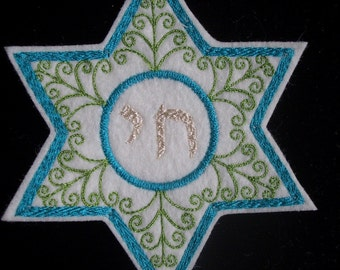 silver chai embroidered in a teal and green star of david iron on patch