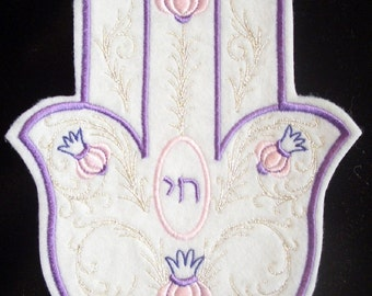 Elegant embroidered hamsa with silver swirls and pink and purple accents iron on patch