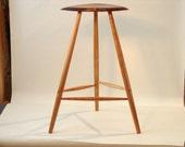Sculpted walnut 3 legged stool C19004