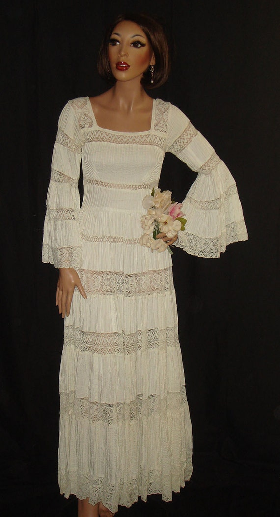 Vintage 1960s White Mexican Wedding Dress with sheer lace and bell sleeves by designer Gonzalo Bauer, xs