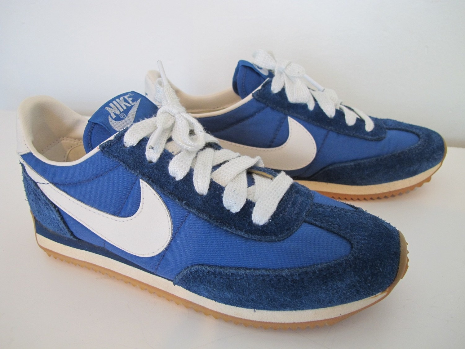 Vintage Blue and White Leather Nike Swoosh by FlowerheadVintage