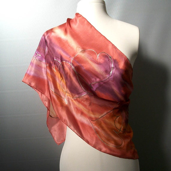 Hearts - Handpainted silk scarf in purple, pink, orange and yellow on coral red with hearts motif