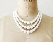 reserved....vintage beaded necklace - 1960s ivory pearl beads / 3 strand necklace