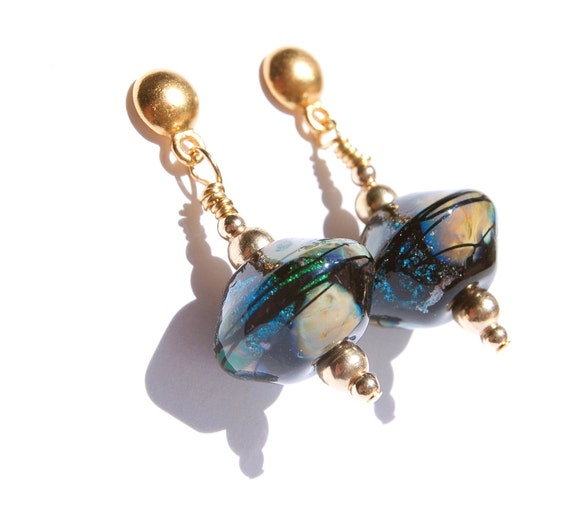 Dangle Lampwork glass bead earrings Black opal colors with swirls of peacock blue and green foil gold beads on gold post Glass bead earrings