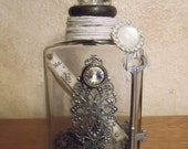 Embellished vintage bottle assemblage