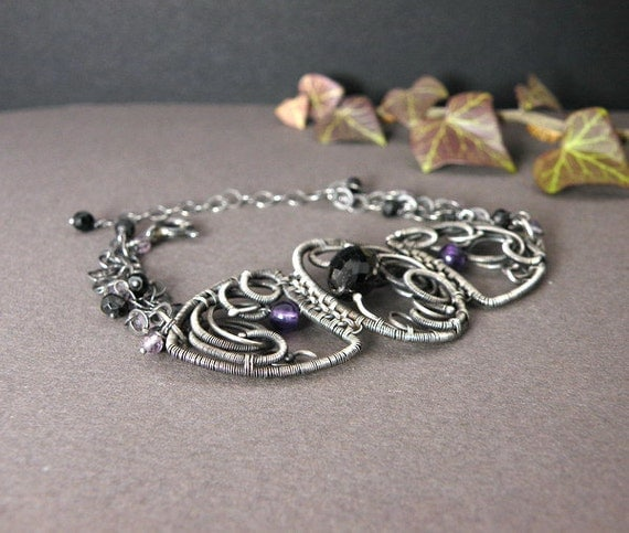 Silver wire wrapped bracelet with  black spinel and amethyst