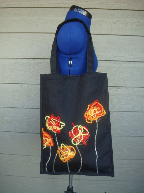 Fashionable purse designed for any occasion made from recycled materials. Size  -17x13.5