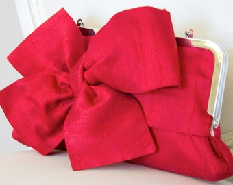 Red silk bow clutch bag