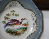 Light blue lustreware bird plate