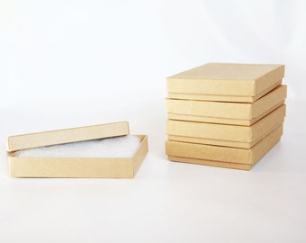 1 Sample Box - Kraft  Boxes filled with cotton 5 1/4 x 3 3/4  x 7/8  Works great for photography presentation