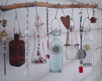 Example of Made when ordered Bottle Chime/Vintage Bottles Embellished with Found Objects, buttons beads, etc. OOAK