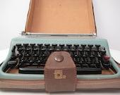 vintage blue OLIVETTI Lettera 22 Italian mid-century portable typewriter