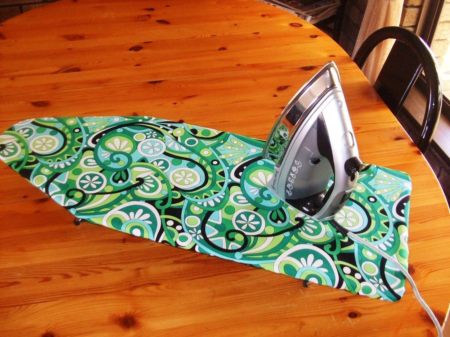 table top ironing board cover retro green and black swirls. Black Bedroom Furniture Sets. Home Design Ideas