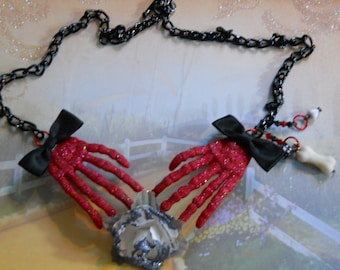 Handcrafted skelton hands necklace
