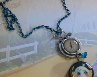 Handcrafted necklace of tattoo sailor girl and vintage freezeplug with charms