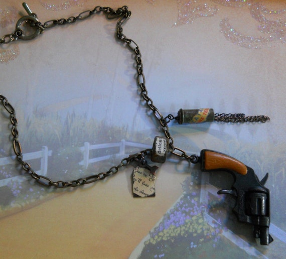 hand crafted vintage metal toy gun, bullet casing and metal charm necklace