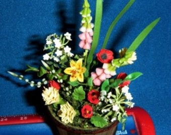 Wonderful floral arrangement in an Al C. bucket