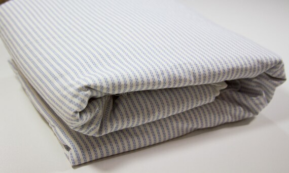 Fitted Crib Sheet, white with blue stripe like design. Bed Skirts available
